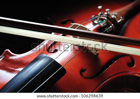 Violin musical instrument on black background - stock photo