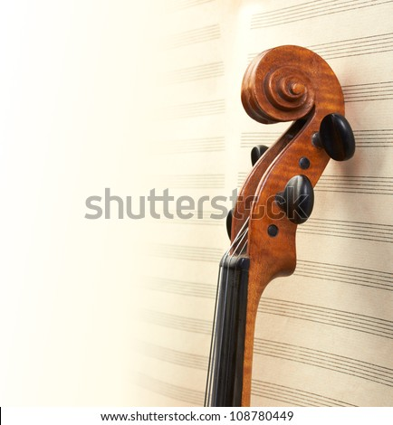 violin neck on musical background - stock photo