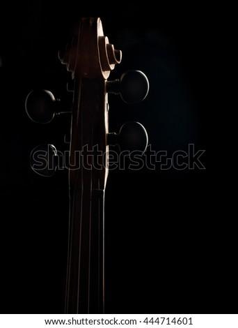 violin neck over black background - stock photo