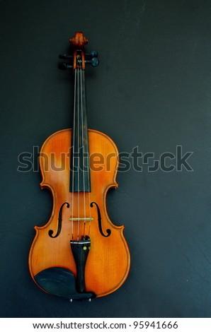 violin on black background - stock photo
