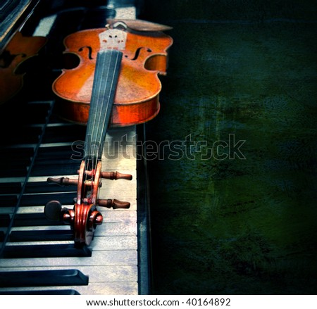 Violin on the piano on a grunge background - stock photo