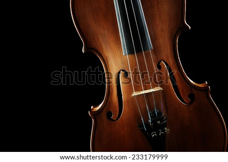 Violin orchestra musical instruments closeup isolated on black background - stock photo