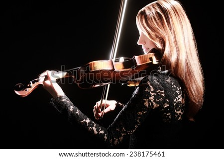 Violin player violinist Music instrument of orchestra Playing violin classical musician - stock photo