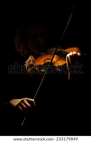 Violin player violinist. Orchestra musical instruments. Classical music playing isolated on black - stock photo