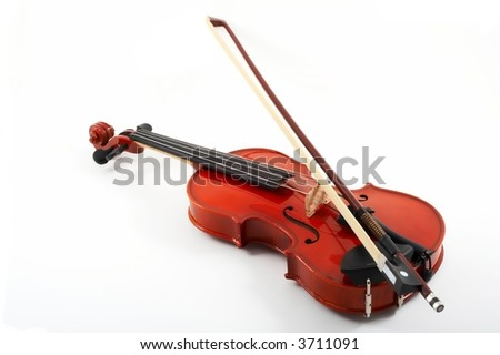 Violin with bow across strings on white background, top, angled view - stock photo
