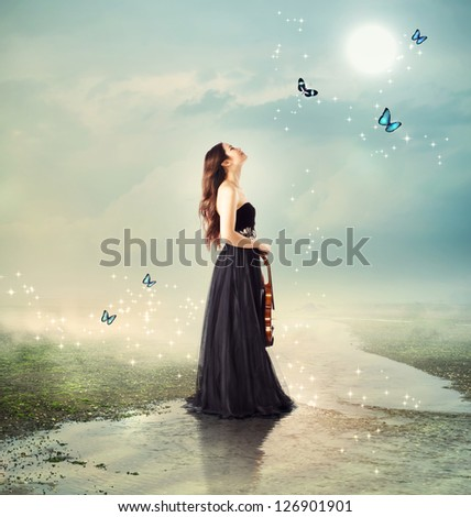 Violinist at a brook under the moon light (with butterflies) - stock photo