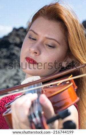 Violinist girl - stock photo