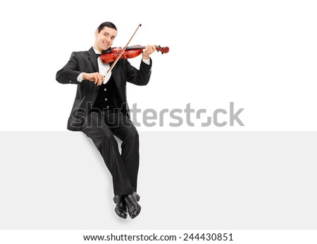 Violinist playing seated on a blank panel isolated on white background - stock photo