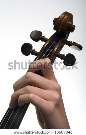 Violinist playing the violin, close-up of the hand and fingers - stock photo