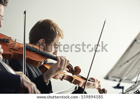 Violinists playing at the concert - stock photo