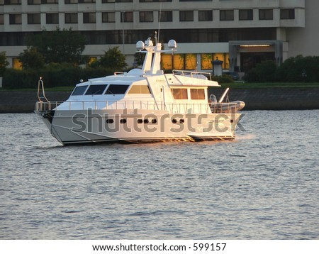 VIP boat at sunset - stock photo