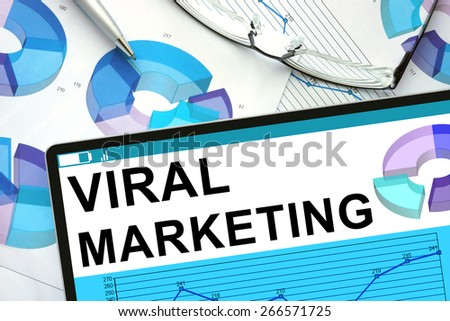Viral Marketing  on tablet with graphs. Business concept.                 - stock photo