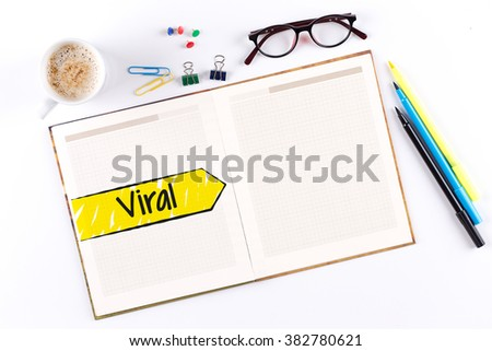 Viral text on notebook with copy space - stock photo