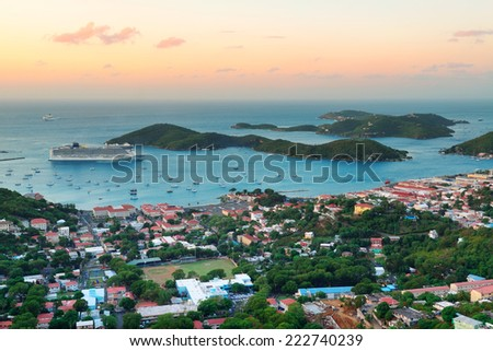 Virgin Islands St Thomas sunrise with colorful cloud, buildings and beach coastline.  - stock photo