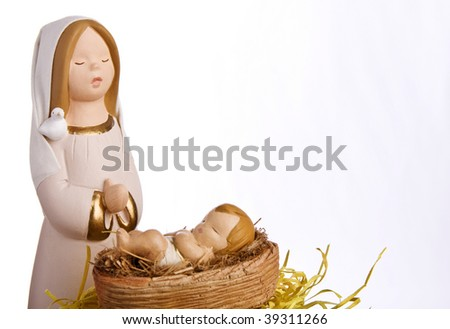 Virgin Mary and baby jesus at the manger. Nativity scene on white background with copy space. - stock photo