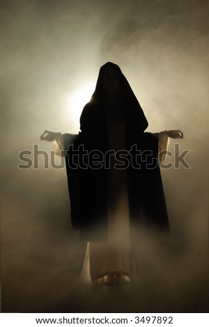 Virgin Mary appearance in a mystical atmosphere. - stock photo