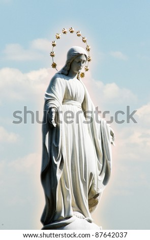 Virgin Mary at the sky background. Blessed Holy Mary in the light glow at clouds. Christian god's mother - Santa Mariya. - stock photo