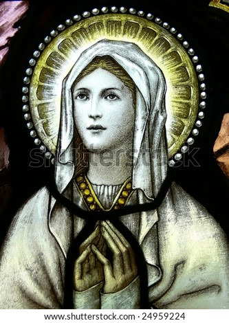 Virgin Mary in stained glass - stock photo