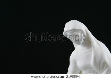 Virgin Mary Statue Against Black - stock photo