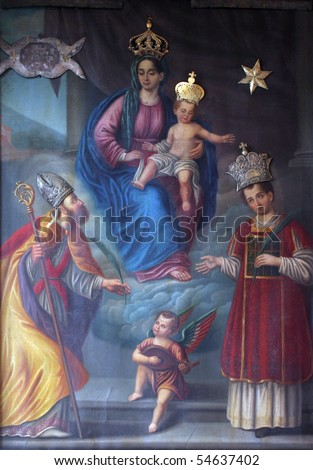 Virgin Mary with baby Jesus and saints - stock photo