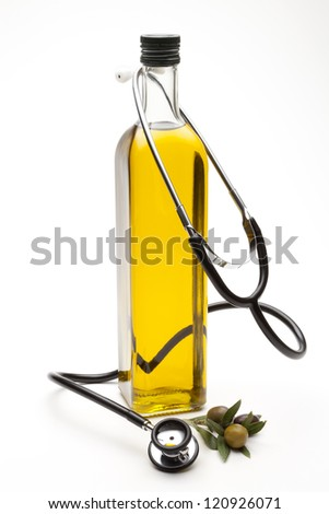 virgin olive oil with stethoscope - stock photo