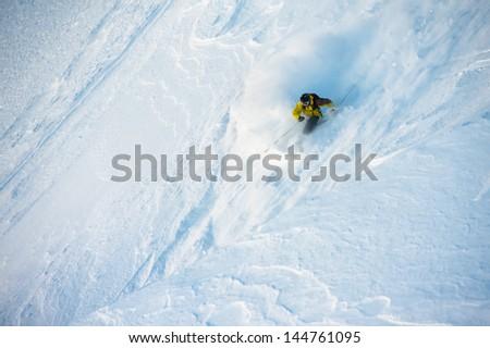 Virgin snow skier. Off-piste. - stock photo