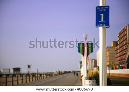 Virginia Beach boardwalk with beach and hotels - stock photo