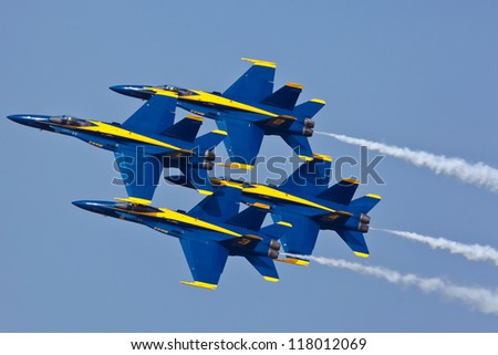 VIRGINIA BEACH - MAY 15:US Navy Blue Angels performing demo routine flying special painted f-18 Hornets on May 15, 2011 in Virginia Beach. Blue Angels are the oldest demonstration team in the world - stock photo