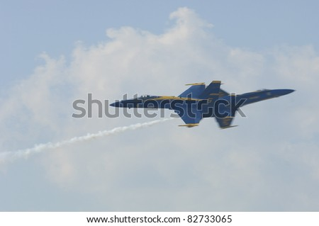 VIRGINIA BEACH, VA - SEPT 17: USN Blue Angel solos opposing pass during the NAS Oceana Air Show on September 17, 2005  in Virginia Beach. VA.