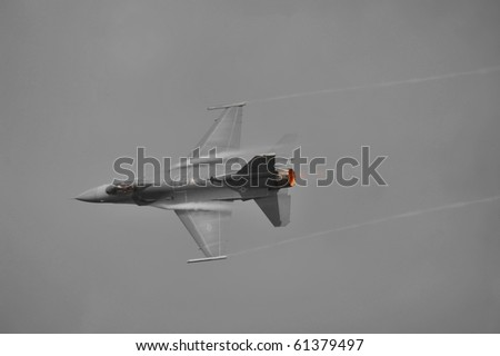 VIRGINIA BEACH, VA - SEPTEMBER 18:  F-16 Fighting Falcon zooms over the crowd at the Naval Air Station Oceana Air Show on September 18, 2010 in Virginia Beach, VA.