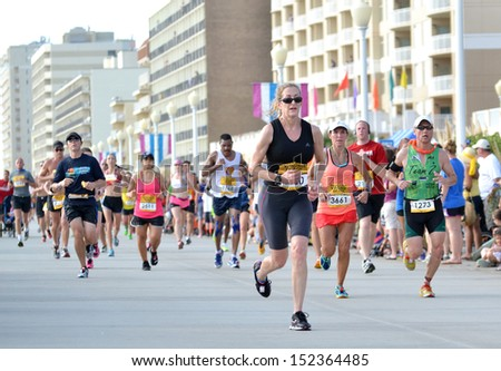 VIRGINIA BEACH, VIRGINIA - SEPTEMBER 1: Runners compete in the Rock N Roll Half Marathon Series in Virginia Beach, Virginia September 1, 2013 - stock photo