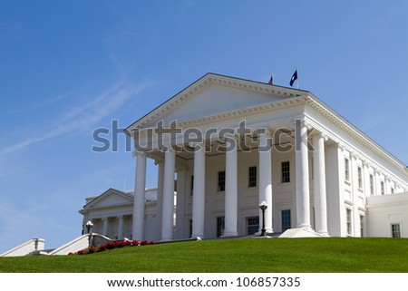Virginia Statehouse building in Richmond, Virginia, USA against a blue sky background. - stock photo