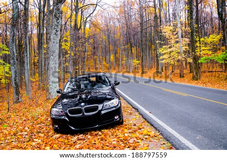 VIRGINIA, USA - OCTOBER 20, 2012: Photo of BMW 3 Series car at skyline drive in Virginia, USA. The BMW 3 Series is a compact executive car manufactured by the German automaker BMW since May 1975. - stock photo