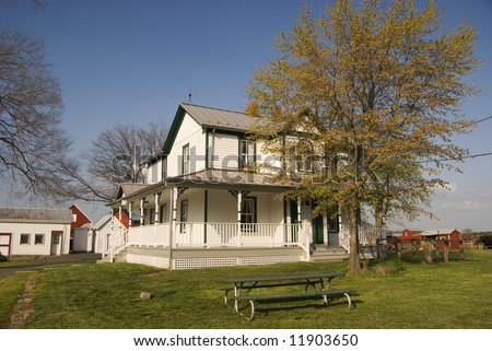 Virginian house with wrap-around porch - stock photo