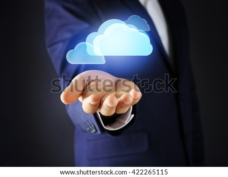Virtual clouds on hand. Cloud storage concept with copy space - stock photo
