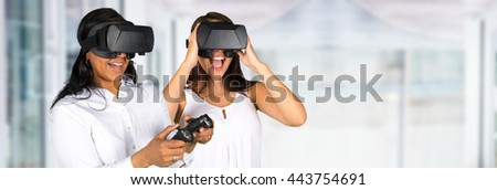 Virtual reality glasses being used by a happy woman - stock photo
