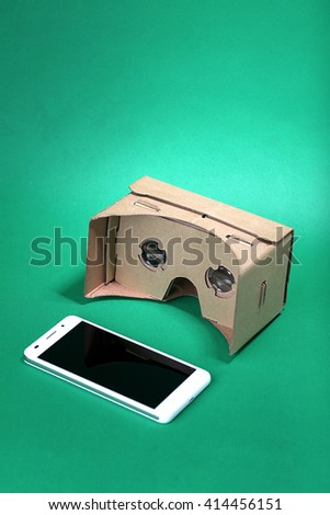 Virtual reality glasses in front of the green background