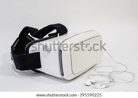 Virtual reality headset in white with headphones. Lenses are adjustable