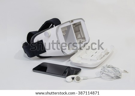 Virtual reality headset with a mobile phone and headphones. Complete vr equipment for a 3d experience