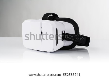 Virtual reality VR glasses or goggles isolated on white background with mirror reflection. Closeup product photograph. Computer simulated reality concept image with copy space
