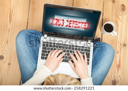 virus detected on laptop - stock photo