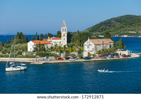 VIS, CROATIA - AUGUST 19, 2012: St. Juraj church, the first sight which greets visitors to on arrival to Vis, the furthest Croatian inhabited island. - stock photo