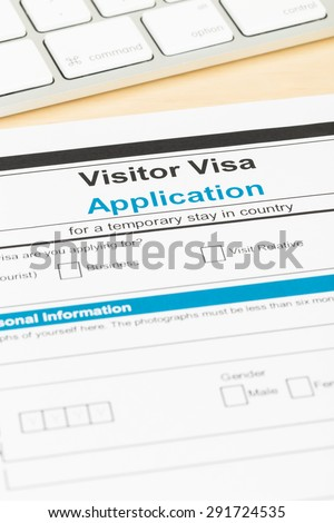 Visa application form with keyboard; form is mock-up