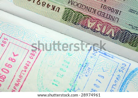 Visa entry and exit stamps in a passport. - stock photo