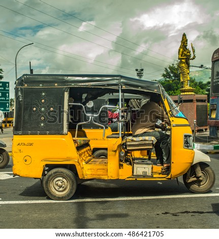 "Visakhapanam(Vizag), India - September18, 2016: Indian auto rickshaws in street. Auto rickshaws (called ""autos"" or ""tuk tuk"") provide cheap transportation in indian cities"