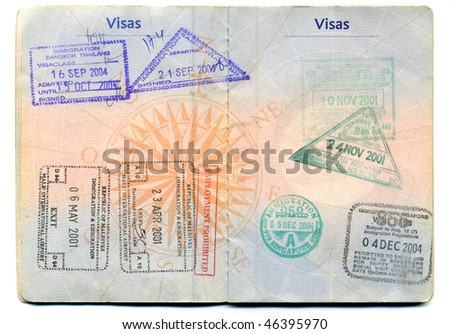 Visas in a passport - stock photo