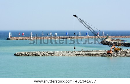 Visby, Sweden - April 2016 : Constructing a new cruising ship pier at the island of Gotland in the Baltic sea in Sweden - stock photo