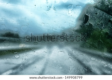 Visibility is limited when driving through a rain storm, raindrops splatter on the windshield of a Jeep driving along Interstate 79 South in West Virginia