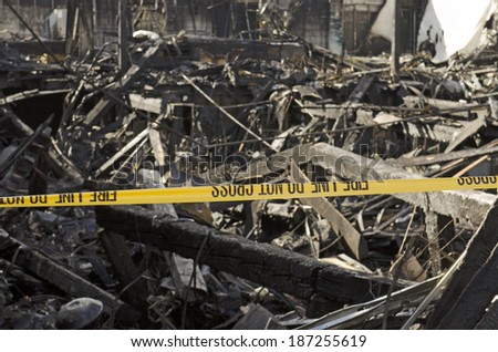 Visible damage to a commercial building following a structure fire - stock photo