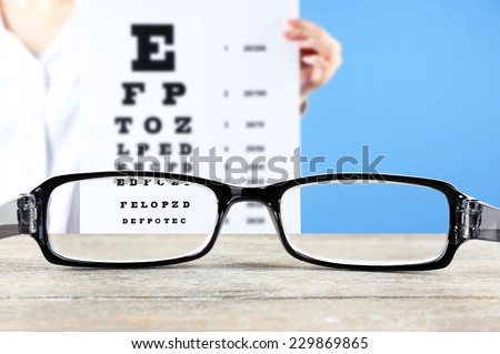 Vision concept. Eye glasses on wooden table